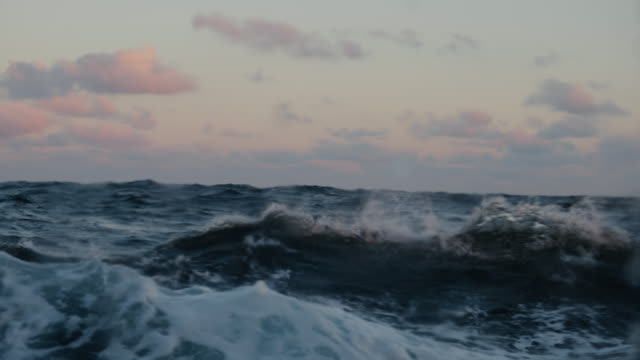 From the porthole window of a vessel in rough sea - video
