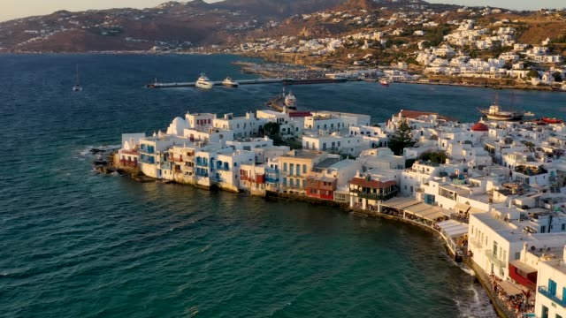 From the windmills above Mykonos town to the little Venice district, Greece From the famous windmills above Mykonos town to the little Venice district in soft summer sunset light, Greece aegean sea stock videos & royalty-free footage