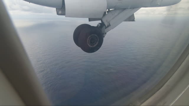 POV from window of small commuter aircraft preparing to land