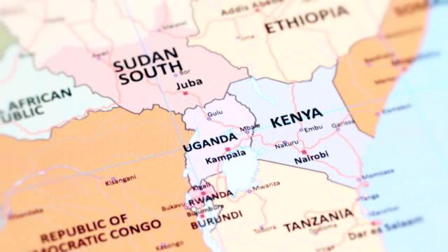 vídeos de stock e filmes b-roll de africa uganda from world map - quénia