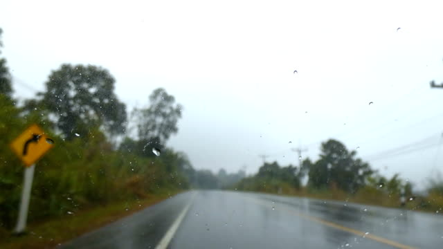 4K Front car view moving on countryside unsmooth road with rain drop and shake video