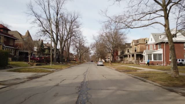 Front center view driving through dangerous neighborhoods Detroit Michigan 4k Front center view driving through dangerous neighborhoods Detroit Michigan 4k district stock videos & royalty-free footage