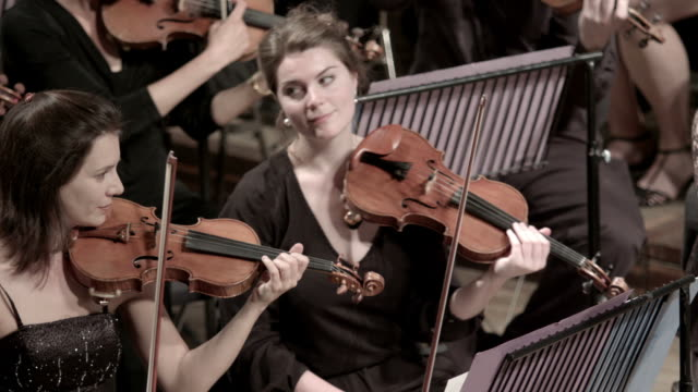 Front desk violinists in symphony orchestra video