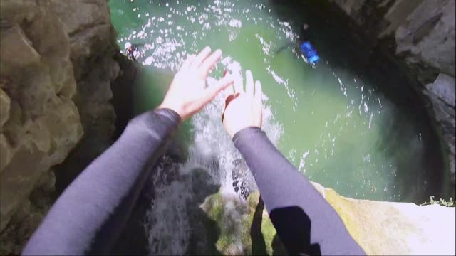 Front flip jump into water on a canyoning adventure