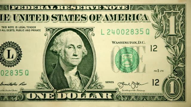 vídeos y material grabado en eventos de stock de anverso de $1 dólar moneda factura de los estados unidos de américa - recesión
