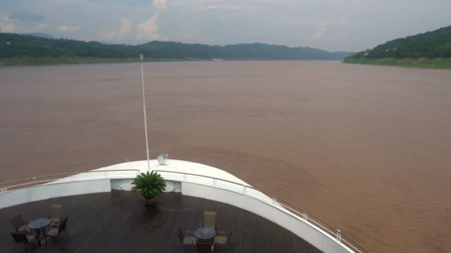 Front of a cruise ship sailing on muddy Yangtze river during summertime in China