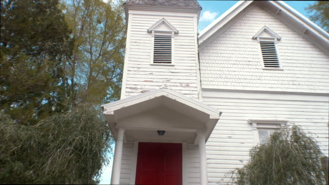 front of old, wooden church building - coloniale video stock e b–roll