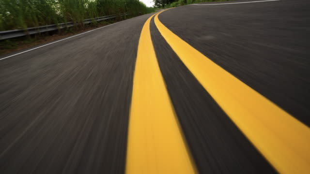 Front pov view of fast car driving on asphalt road