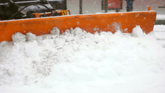 Front shot of plower cleaning up snow Detail of car plowing snow from city platform plow stock videos & royalty-free footage