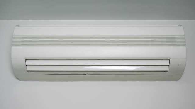 Front view at an operating air conditioner. (loop ready video) video