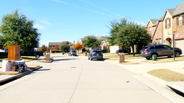 Front View Driving Through Residential Houses In Suburban Estate Street