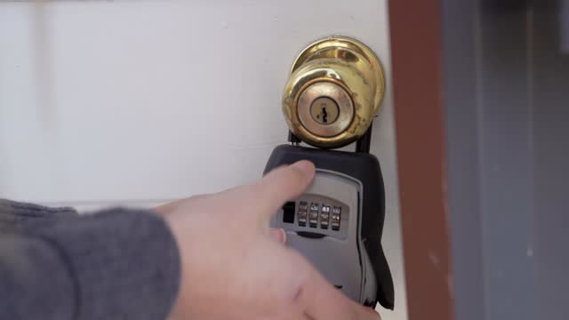 front view hands opens key lockbox real estate video