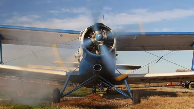 Front view of an old russian biplane with engine running Front view of an old russian biplane with engine running propeller airplane stock videos & royalty-free footage
