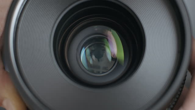Front View of Cinema Glass Lens and Opening of Metal Irıs Blades Diaphragm with Aperture Mechanism of Camera