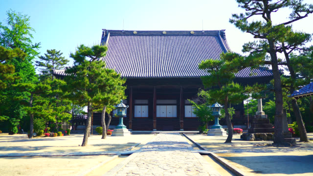 front view of japanese traditional temple - tempio video stock e b–roll
