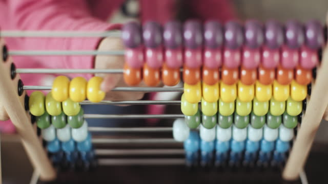 Front view of little cheerful girl playing with abacus at home stock video... Front view of little cheerful girl playing with abacus at home genius stock videos & royalty-free footage