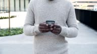 istock Front view of man texting on smartphone during stroll 1216832616