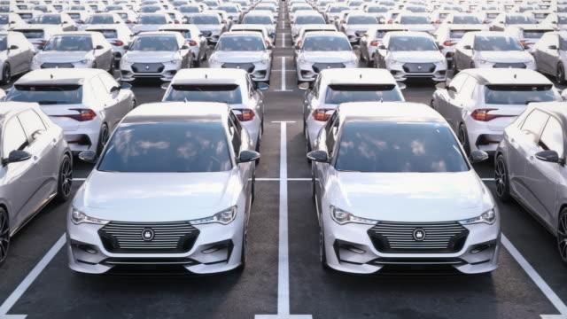 stockvideo's en b-roll-footage met vooraanzicht van nieuwe elektrische zelfrijdende auto's op enorme opslag parkeerplaats - parking