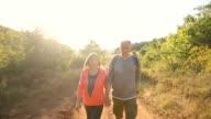 istock Front view of senior couple trekking on sunny autumn day 1170952504