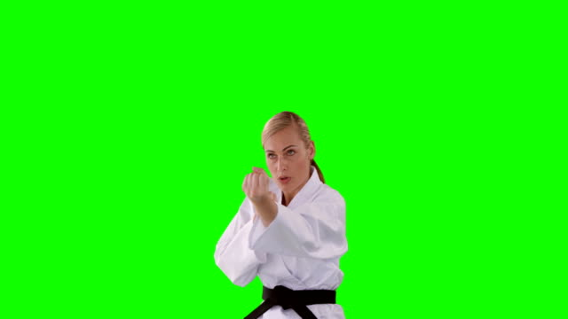 Front view of sportswoman is practising martial art video