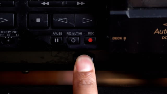 front view: opening cassette  stereo player on the button - mangianastri video stock e b–roll