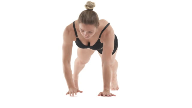 front view portrait of young sportswoman doing walking plank for strong core, back and abdominal muscles. Isolated on white background.