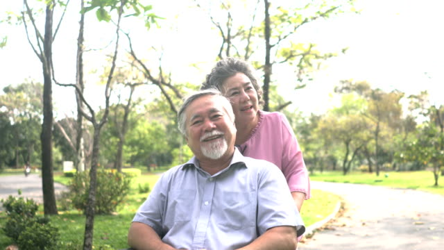 front view: Senior wife still love Senior Asian husband although he can not walk with her video