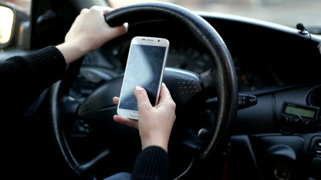 vídeos de stock e filmes b-roll de frontal view of modern smart phone with blank white screen with copy space for your text or design, close up of driver hands using mobile phone in car - phone, travelling, copy space