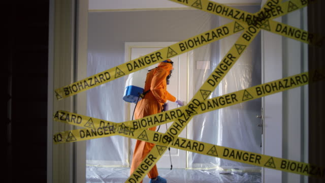 Frontline Worker in Full Hazmat Suit Enters Coronavirus Contaminated Room