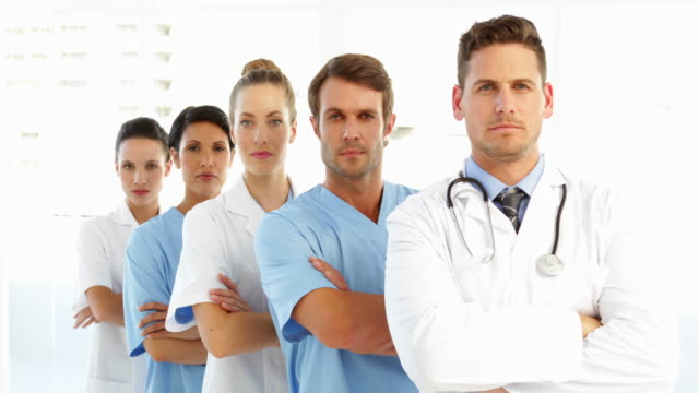 Frowning medical team with arms crossed video
