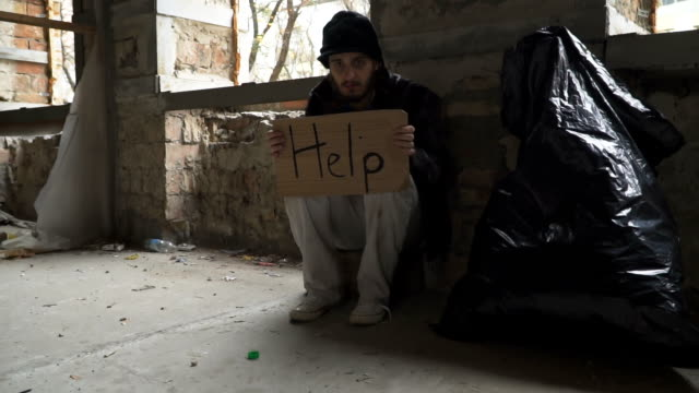 Frozen hungry homeless with cardboard 'help' video