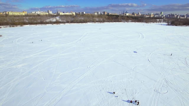 Frozen lake and ice fishing - aerial view video