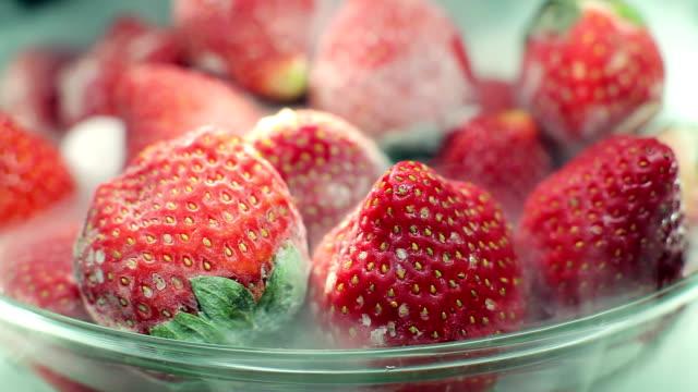 Frozen strawberries Frozen strawberries frozen stock videos & royalty-free footage