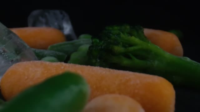 frozen vegetables camera moving,cauliflower,carrots,peas,string beans,concept of healthy - {{relatedsearchurl(carousel.phrase)}} video stock e b–roll