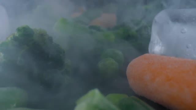 frozen vegetables camera slide,cauliflower,carrots,peas,string beans,concept of healthy - {{relatedsearchurl(carousel.phrase)}} video stock e b–roll