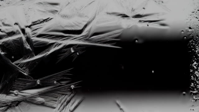 frozen water make patterns on the window video