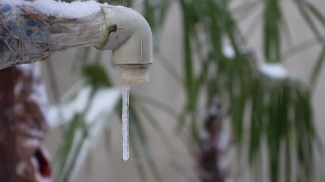 Frozen water pipes. Snow and ice Pipes that are exposed to cold air. Ice on the tap frozen stock videos & royalty-free footage