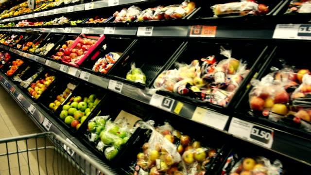 stockvideo's en b-roll-footage met fruit and vegetable section of a supermarket - groot brittannië