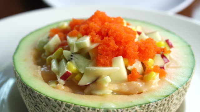 Fruit Salad In Cantaloupe Bowl Scooped Water Melon Melon Salad Dressing And Fish Eggs On Top Healthy Food Stock Video Download Video Clip Now Istock