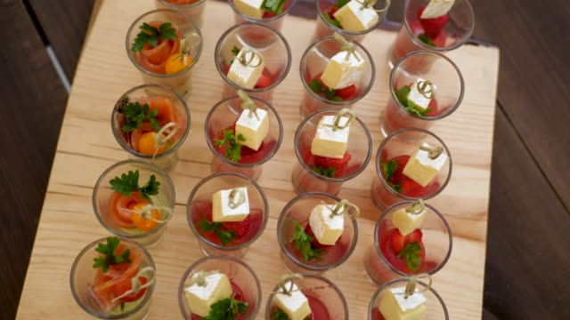 fruit snack in small glass glasses - buffet video stock e b–roll