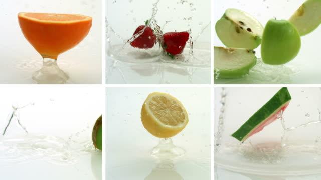 fruit splashing, video montage, slow motion - kiwifrukt bildbanksvideor och videomaterial från bakom kulisserna