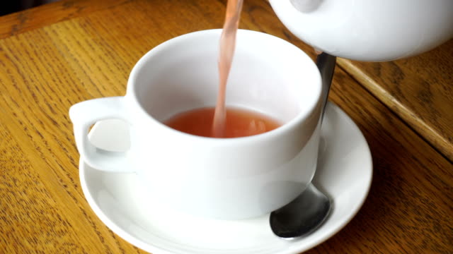 fruit tea is poured into a cup video