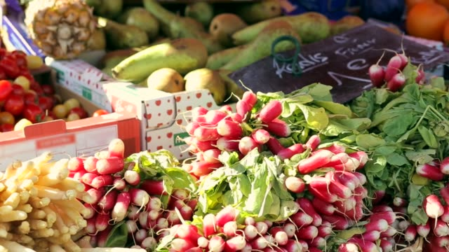 Fruits and vegetables stand at the farmers market place in Dieppe, France. Regional cuisine, natural healthy food and abundance concept video