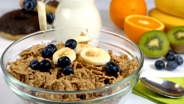 Fruits falling in slow motion on cereals flakes for breakfast video