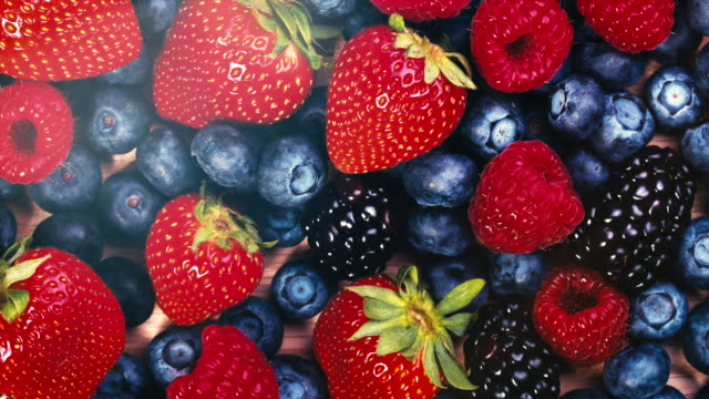 fruits, strawberries, raspberries, blueberries - bacca video stock e b–roll