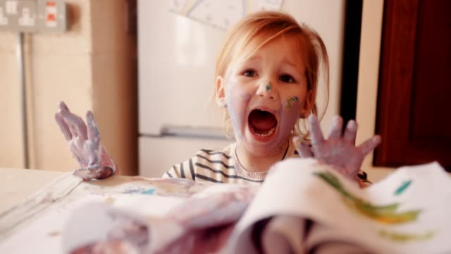 Frustrated child dirty with paints having a tantrum video