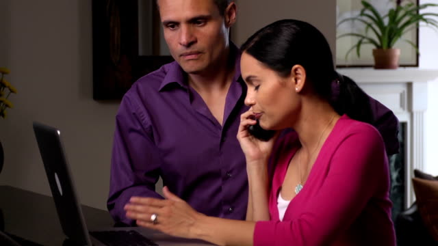 Frustrated Latin Couple Argue with Company over the Phone Medium shot of Latin couple arguing with company representative over the phone. mortgages and loans stock videos & royalty-free footage