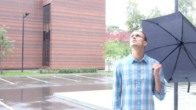 Frustrated with Weather, Standing Under Umbrella during Rain video