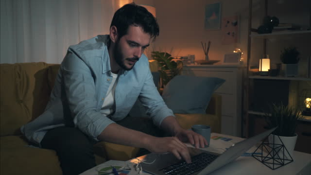 frustrated young man working at home. - fare la lotta video stock e b–roll