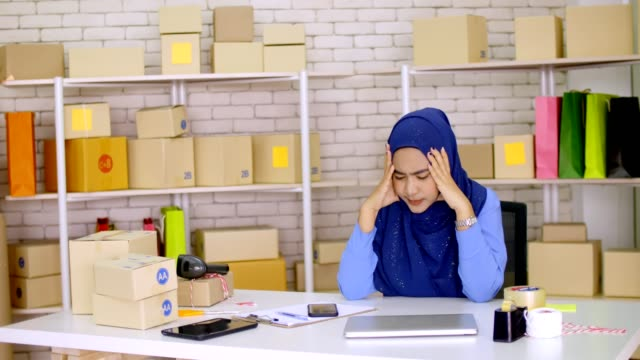 Frustrated young Muslim woman having problem with start up small business entrepreneur freelance working at home video